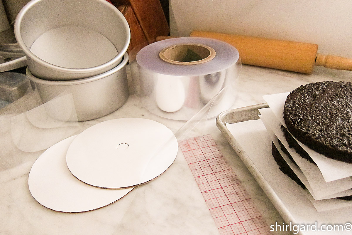 "Tools for assembling Brooklyn Blackout Cake: Two cake pans, 3"" (7.5 cm) wide acetate cake band, 2 cake boards, & C-thru ruler."