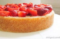 Bottom layer of cake with quartered strawberries